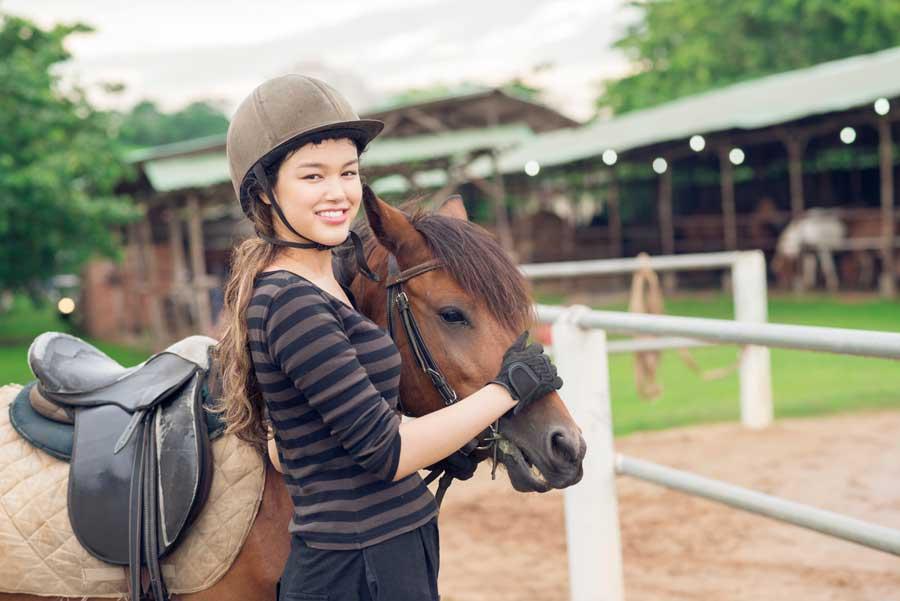 teenage horseback rider