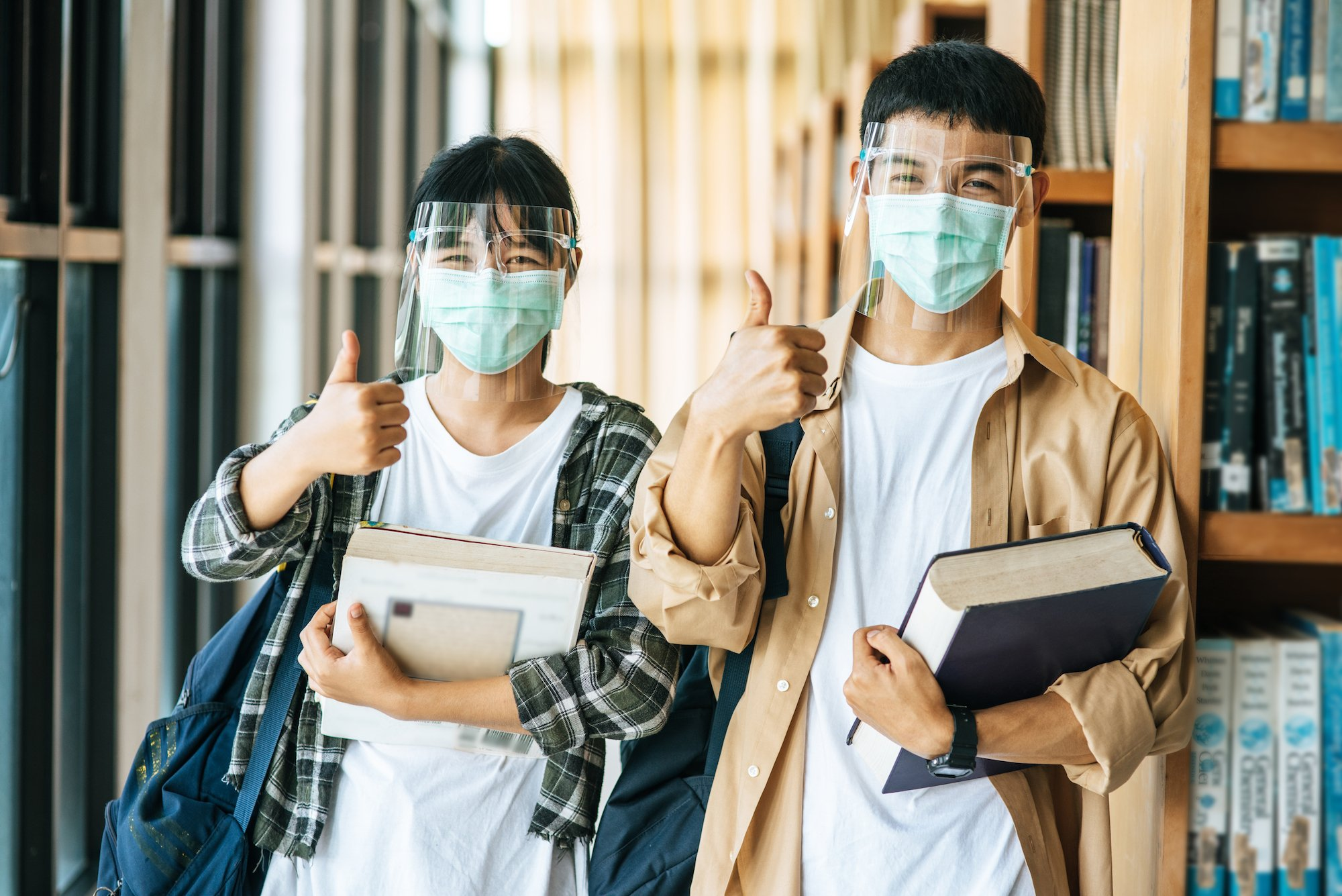 high school students with COVID masks and faceshields